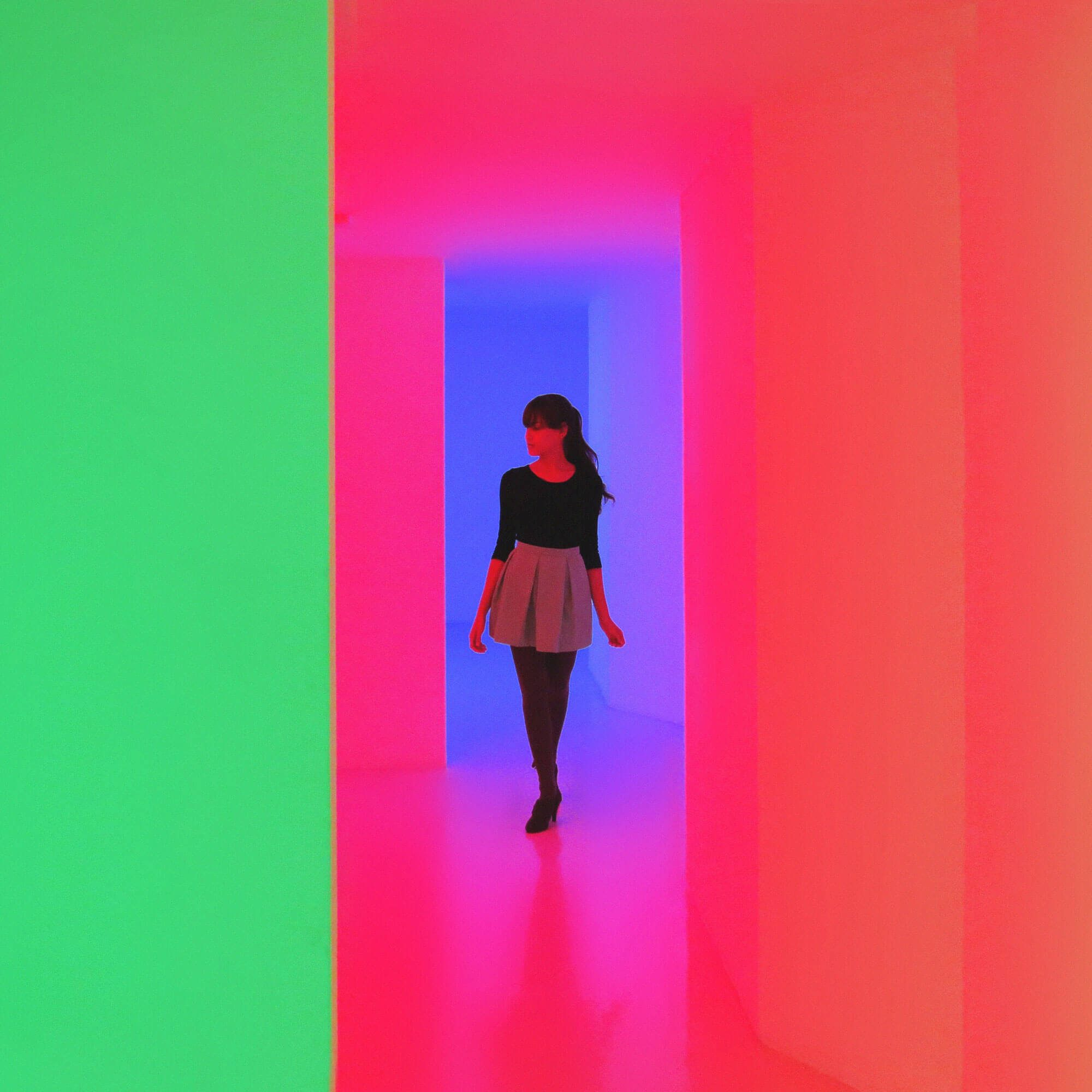 Girl in vibrant corridor