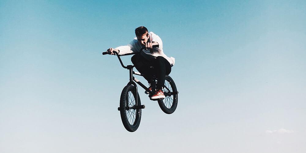 Boy on bmx bike doing stunts