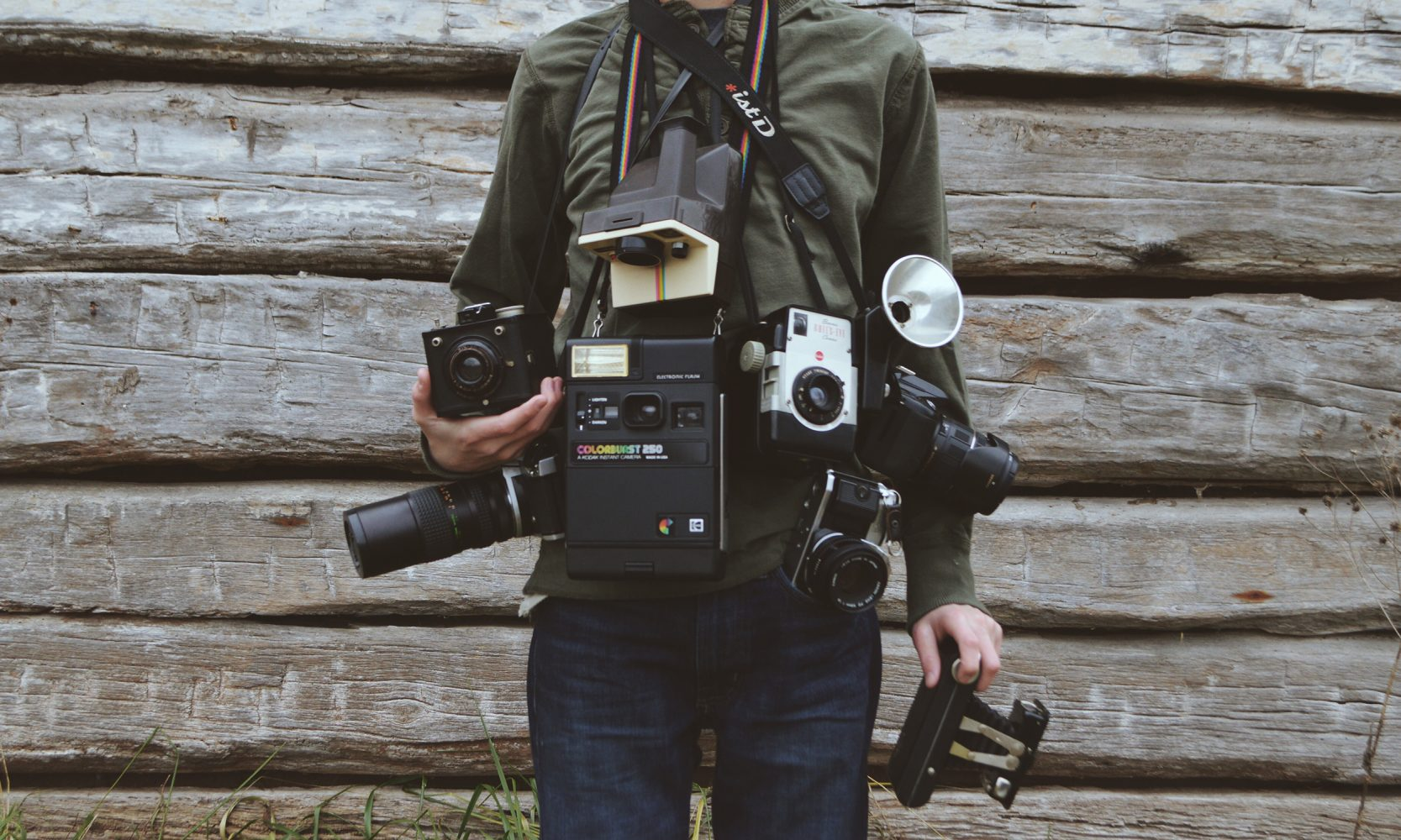 man with vintage camera collection