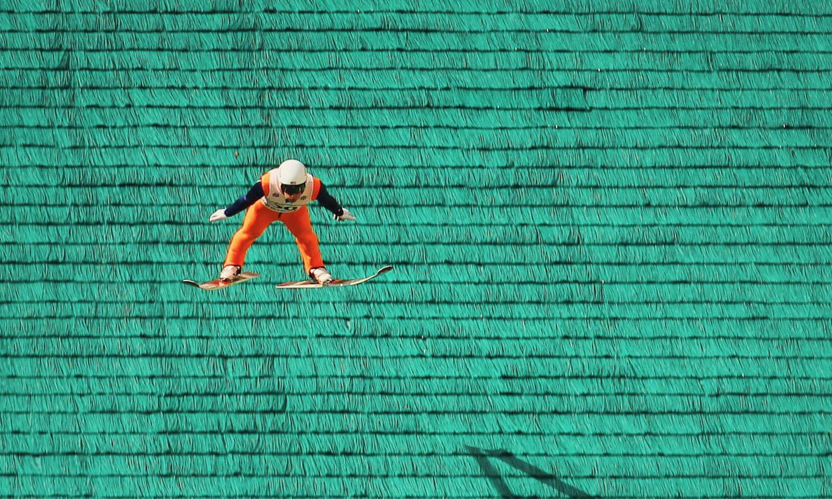 man on skis in air